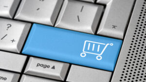 e-commerce-online-shopping-keyboard-blue-shopping-cart-button-nki